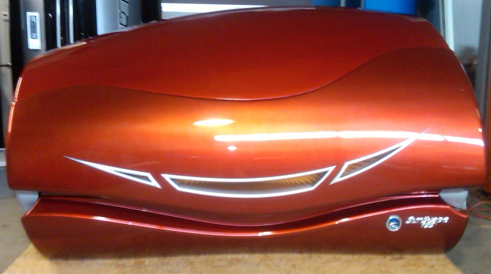 photo of a used ETS Sunscape 755 orange color closed lid